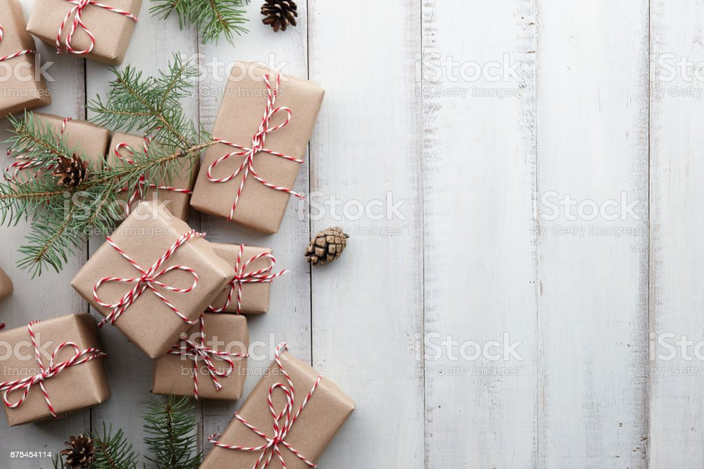 Christmas presents and gift boxes wrapped in kraft paper stock photo