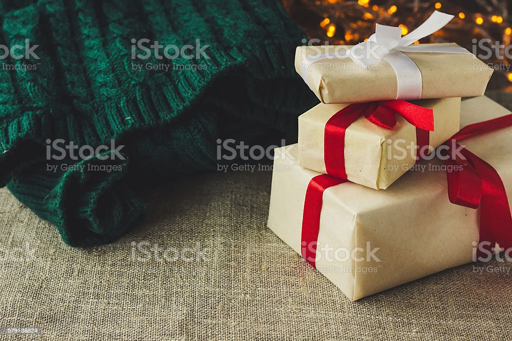 Christmas presents and green pullover stock photo