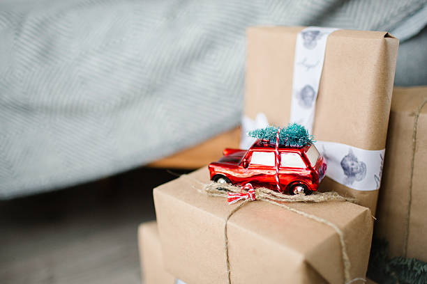 Christmas presents in boxes wrapped in natural paper with toy stock photo