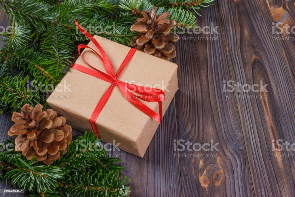 Christmas presents in decorative boxes, white wood background.