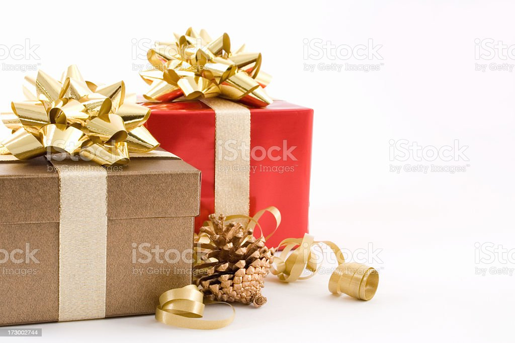 Christmas presents neatly wrapped with golden bows stock photo