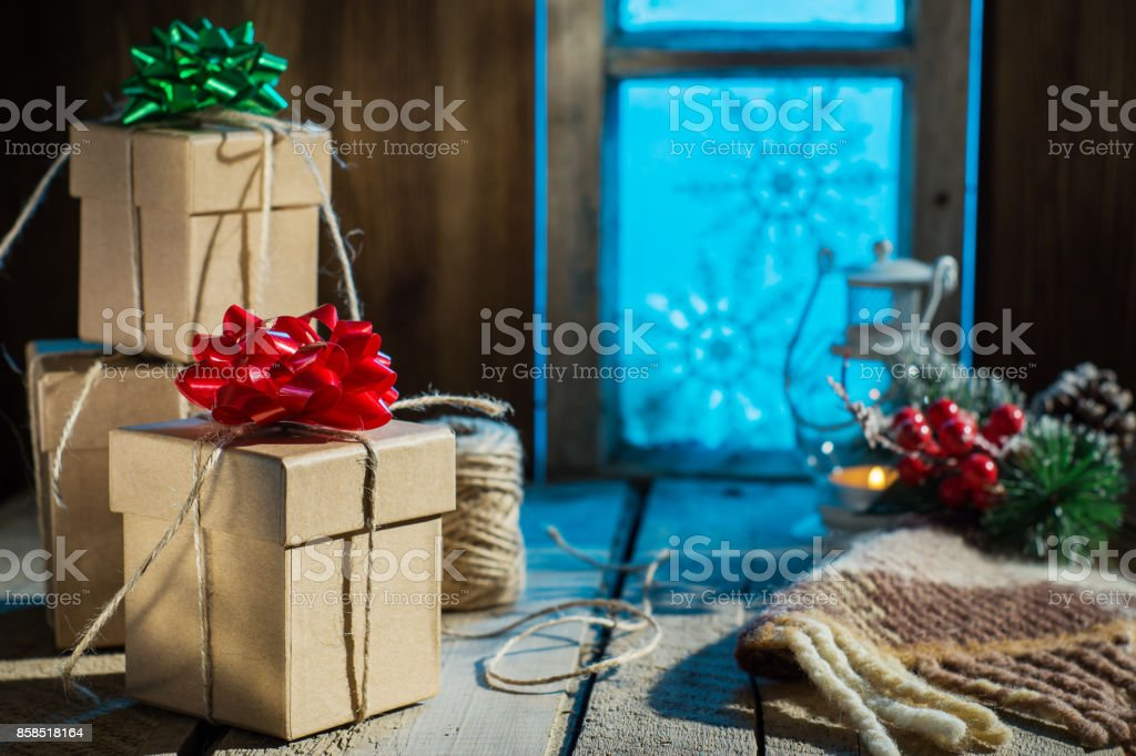 Christmas presents on old wooden table. stock photo