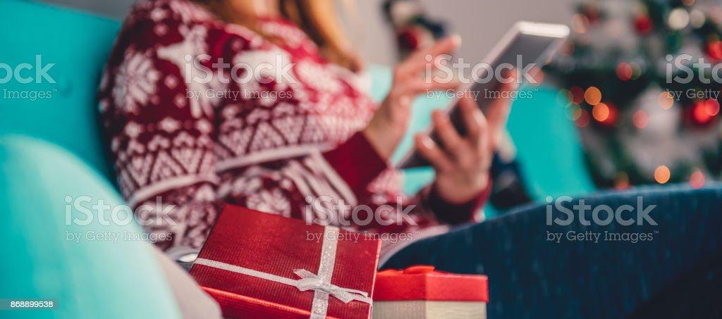 Christmas presents on the sofa stock photo