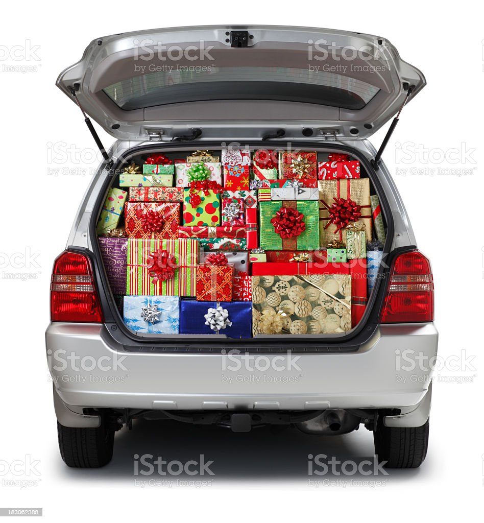 Christmas presents stuffed into SUV isolated on white background stock photo