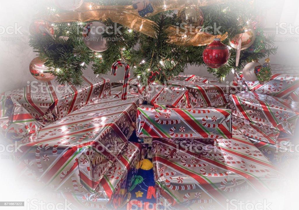 Christmas Presents under a Christmas Tree stock photo