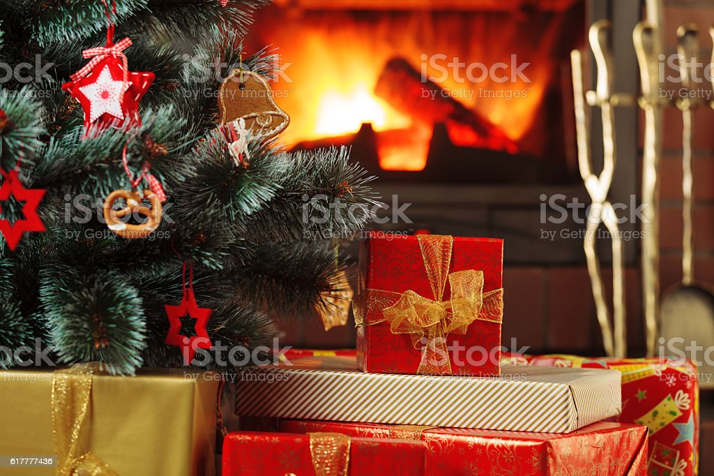 Christmas presents under the Christmas tree on the background of stock photo