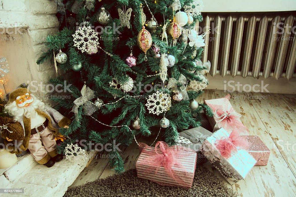 Christmas presents under the fir on the floor stock photo