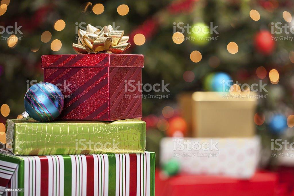 Christmas presents under the tree stock photo