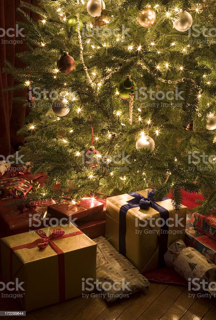 Christmas Presents Under Tree.Christmas Presents Under Tree Stock Photo Download Image Now