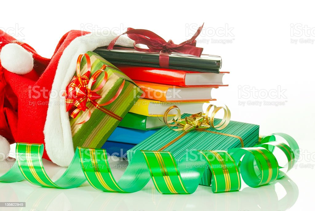 Christmas presents with e-book reader and books in bag stock photo