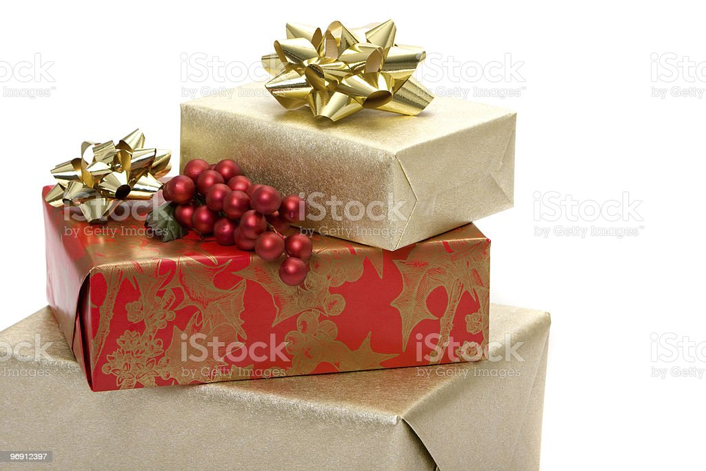 Christmas presents with holly royalty-free stock photo