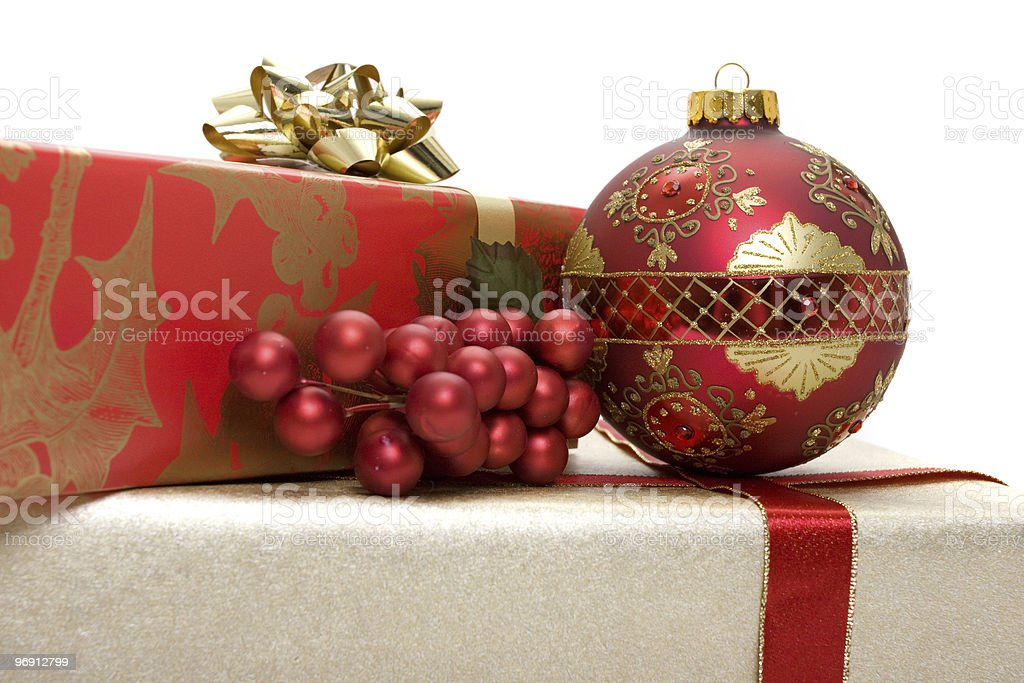 Christmas presents with ornament and holly royalty-free stock photo