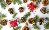 istock Christmas presents with pine cones festive background 894690706