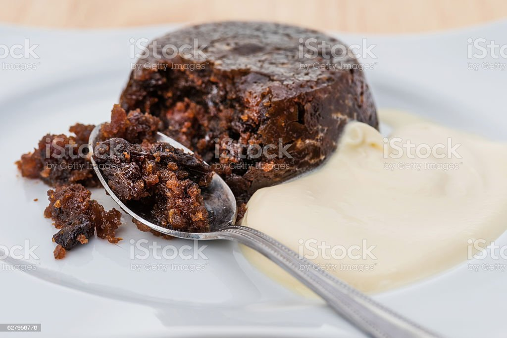Christmas pudding and cream stock photo