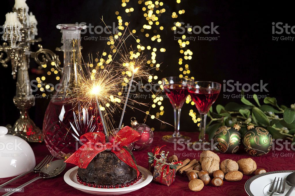 Christmas pudding and sparkling fire royalty-free stock photo