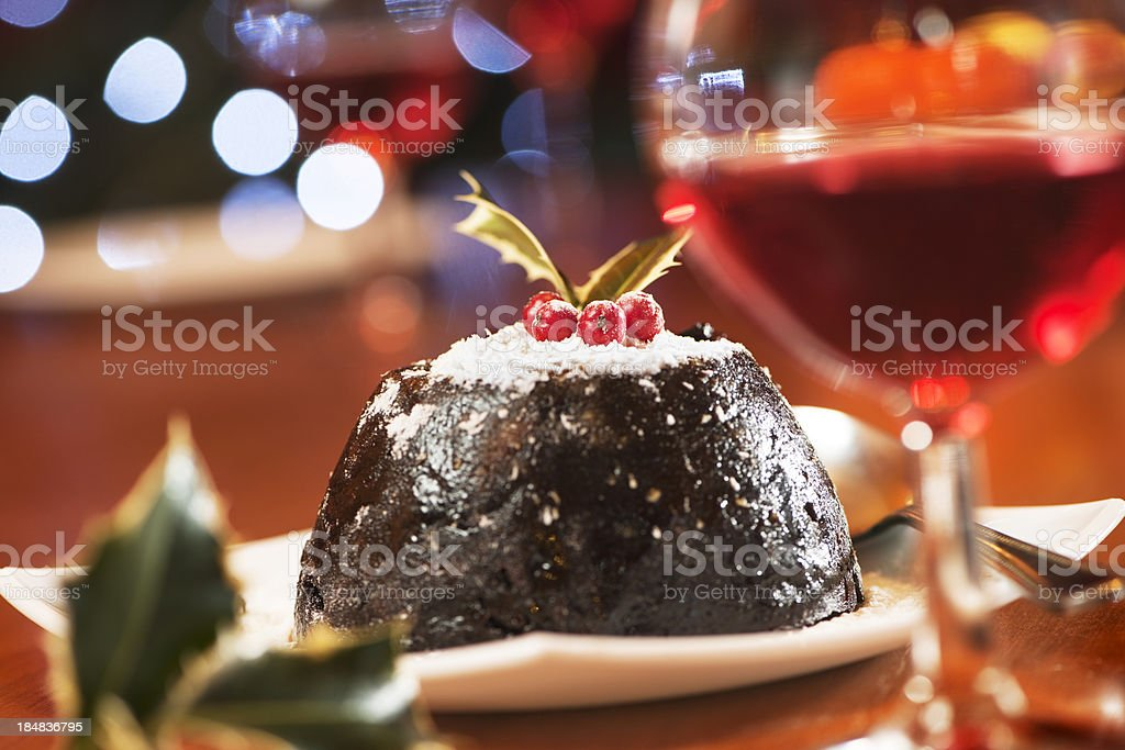 Christmas pudding and wine in warm colours scene stock photo