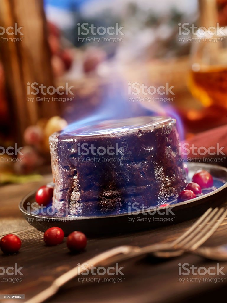 Christmas Pudding Flaming with Brandy stock photo