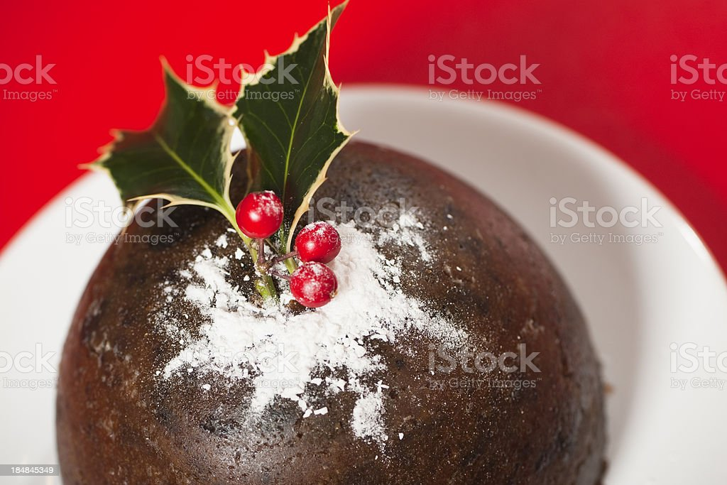 Christmas pudding on red background royalty-free stock photo