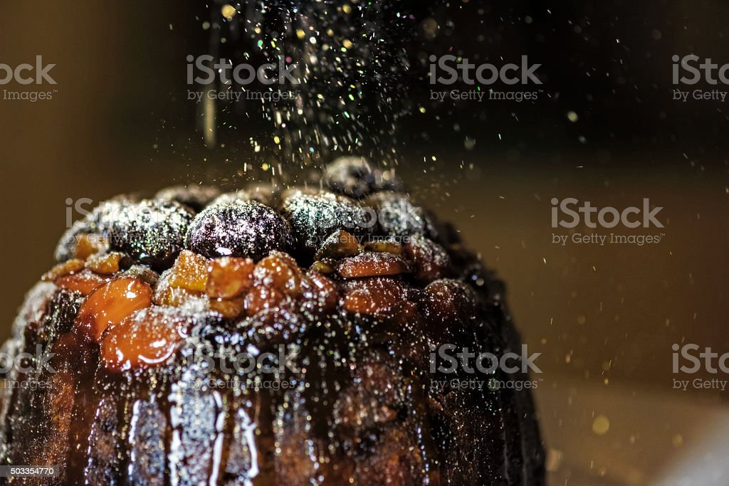 Christmas Pudding with Golden Glitter Sugar 1 stock photo