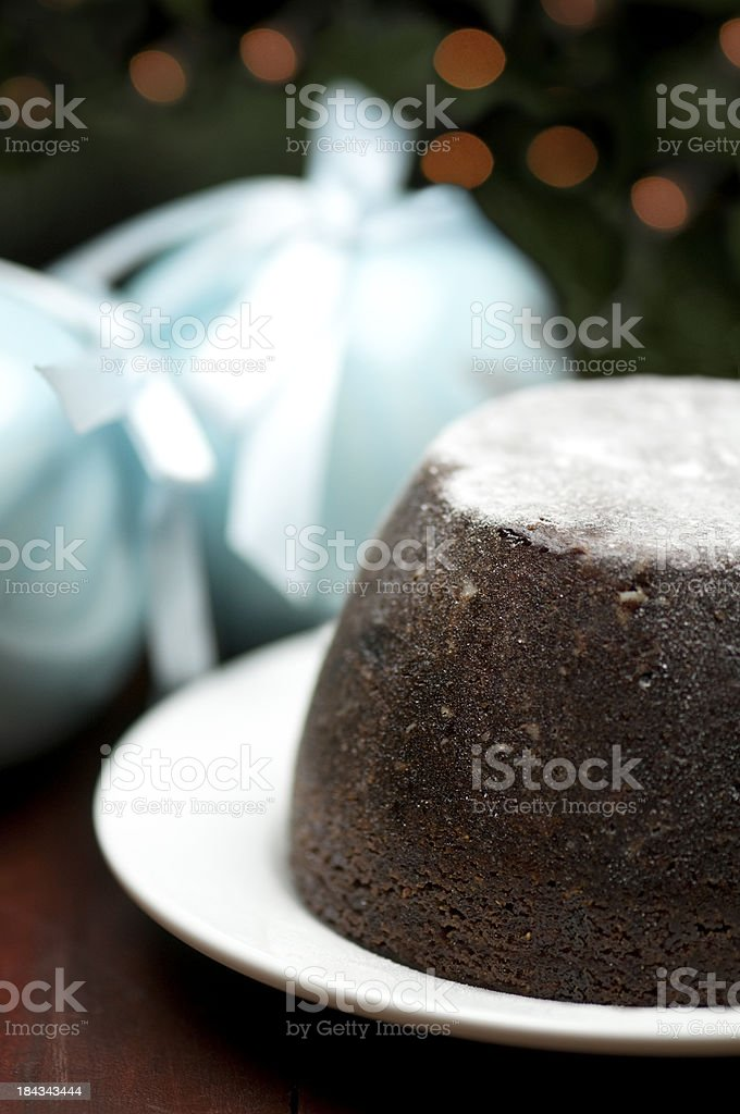 Christmas pudding (dessert) with ornaments and tree royalty-free stock photo
