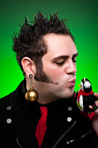 christmas punk kissing ornament - punk music stock photos and pictures