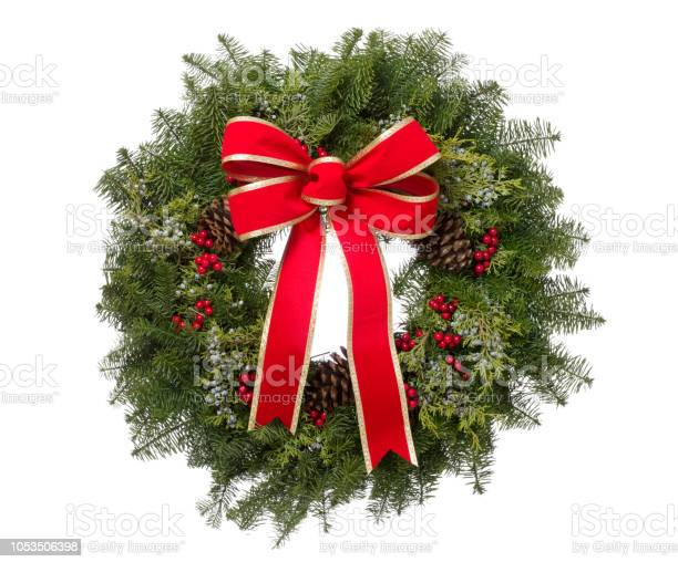 Christmas real pine wreath with big red bow isolated picture id1053506398?b=1&k=6&m=1053506398&s=612x612&h=awzdmexvdcrkxuhq wjxjieea1atmhd9elqhtlfrkwq=