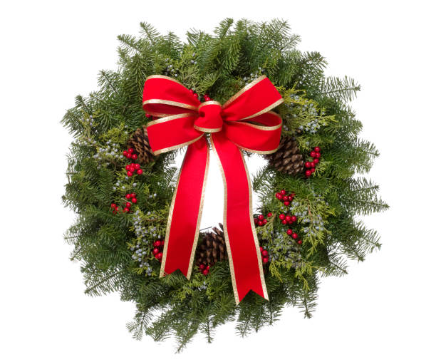 Christmas real pine wreath with big red bow isolated stock photo