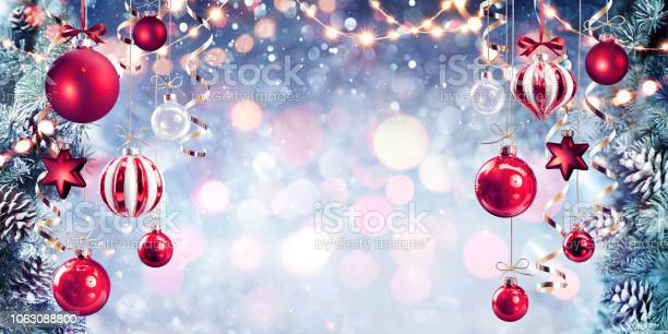 Christmas red baubles hanging with fir branches in shiny background picture id1063088800?b=1&k=6&m=1063088800&s=612x612&h=vzerxguohfbihm0o8idmp6wncpqb2zkbwl1zlvccnua=