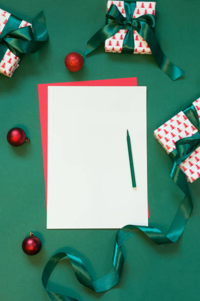 christmas red blank for letter to santa on green. - list stock photos and pictures