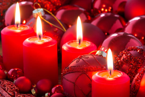 Christmas red candles with candle light and decoration stock photo
