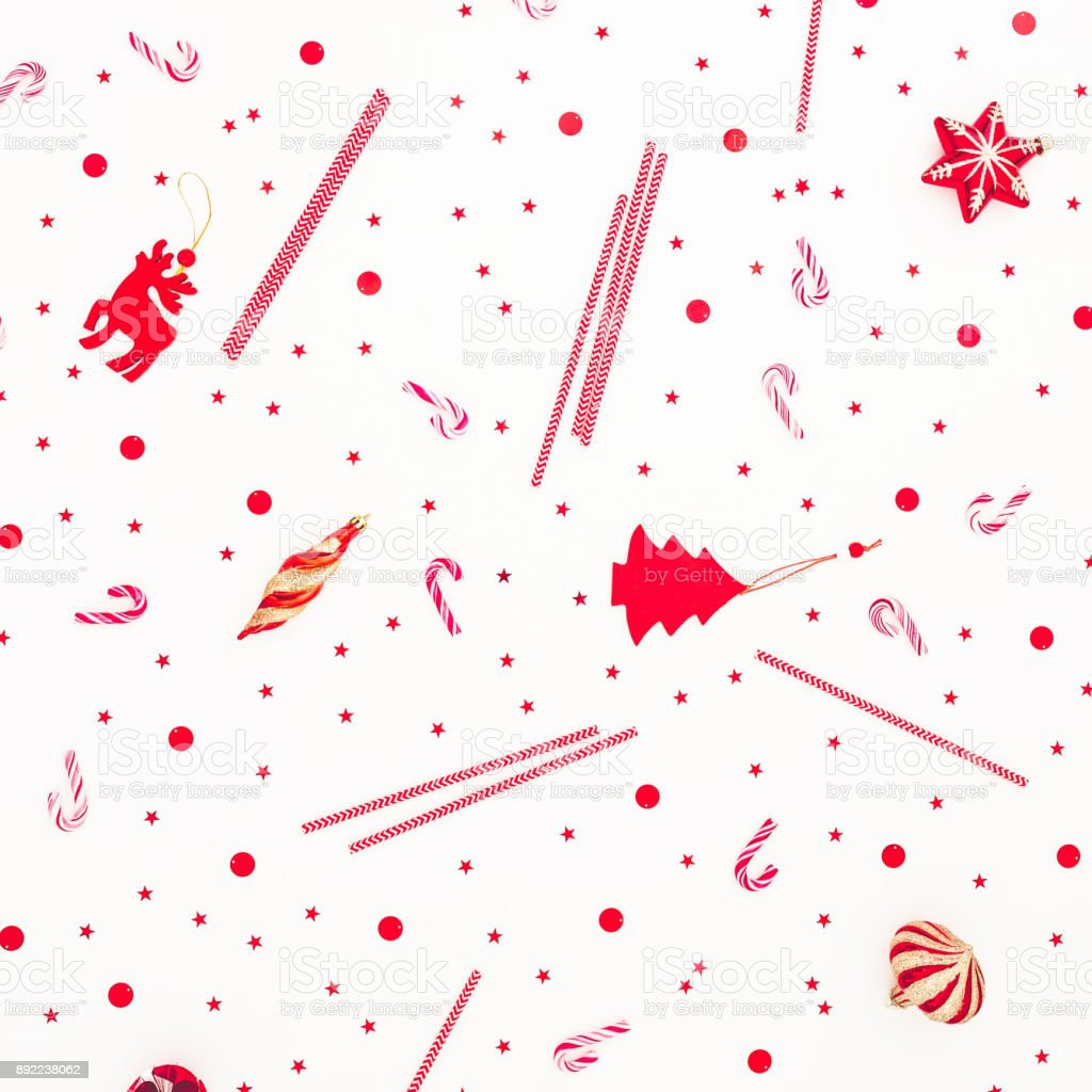 Christmas Red Decoration Candy Cane And Confetti On White Background