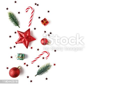 istock Christmas Red decorations, fir tree branches on white background. 1180442516