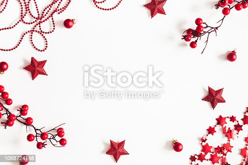 1074095098 istock photo Christmas red decorations on white background. Christmas, new year, winter concept. Flat lay, top view, copy space 1068724148