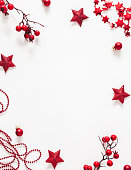 istock Christmas red decorations on white background. Christmas, new year, winter concept. Flat lay, top view, copy space 1282477074