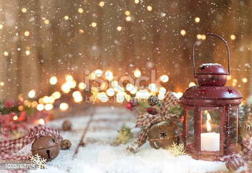 Christmas Red Lantern on an Old Wood Background