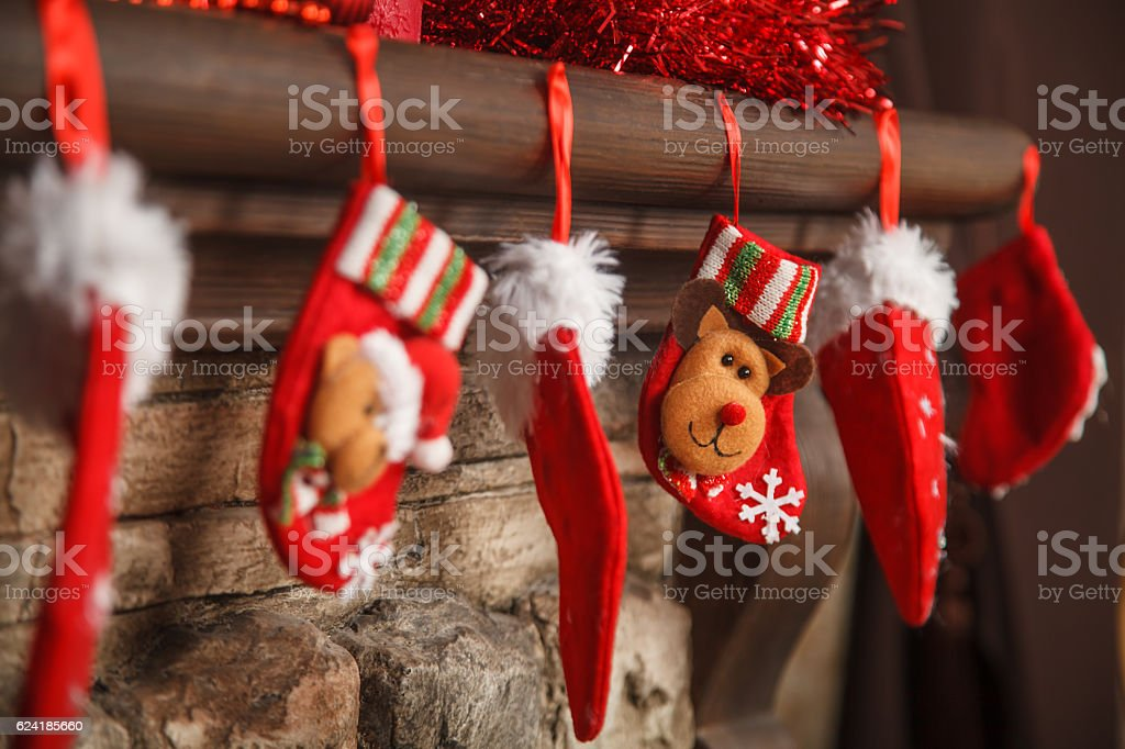 Christmas red stocking hanging from a mantel or fireplace, decor stock photo