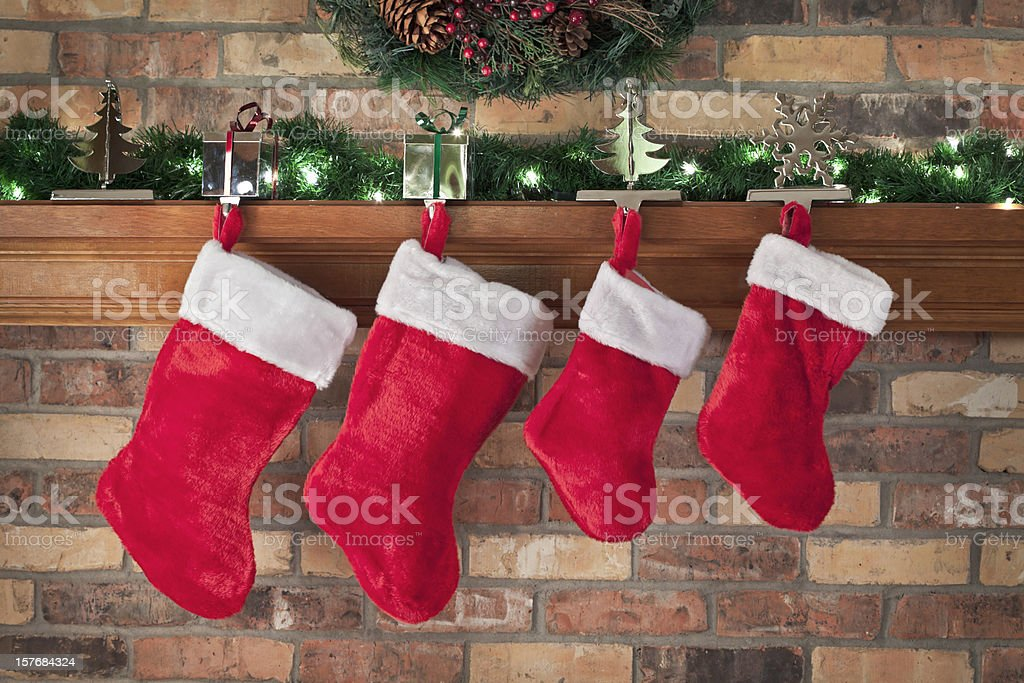 Christmas, Red Stockings, Brick Wall, Mantel, Decorations stock photo