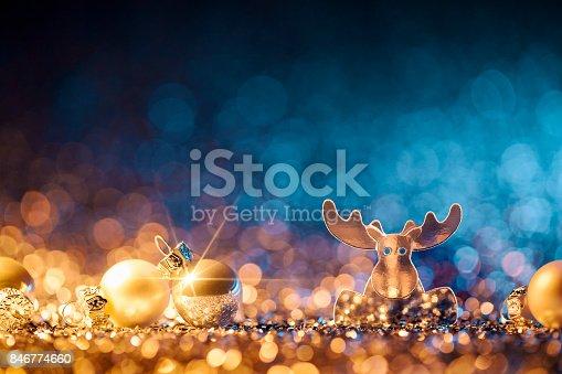 istock Christmas Reindeer - Defocused Decoration Gold Blue Bokeh 846774660