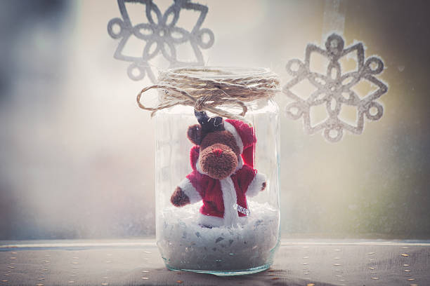 Christmas reindeer in glass jar decoration stock photo