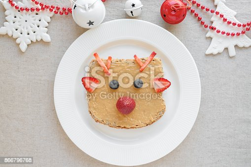 istock Christmas reindeer on peanut butter toast breakfast, fun food art for kids 866796768