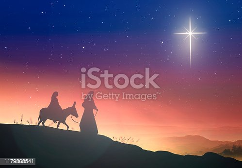 Silhouette pregnant Mary and Joseph with a donkey on star of cross background