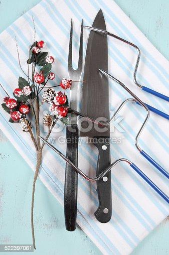 istock Christmas roast turkey carving utensils set 522397061
