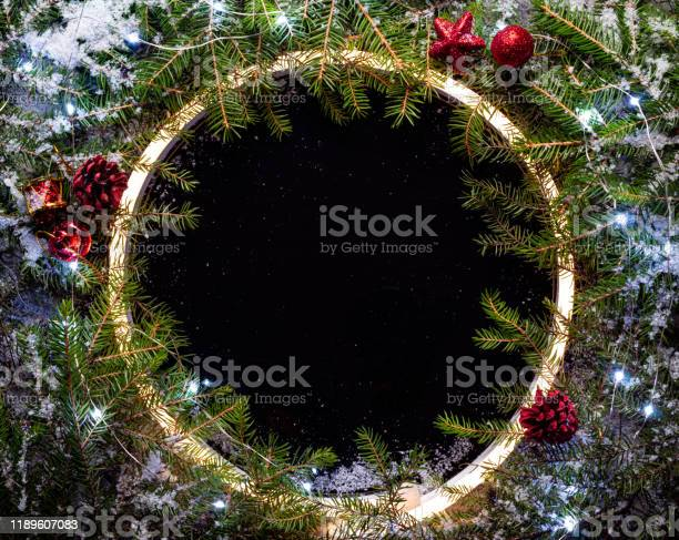 Christmas round frame made by neon and winter things on black picture id1189607083?b=1&k=6&m=1189607083&s=612x612&h=eq9f13q4mg2flytv1udcqieajsmuccfsqvmxhffinu0=