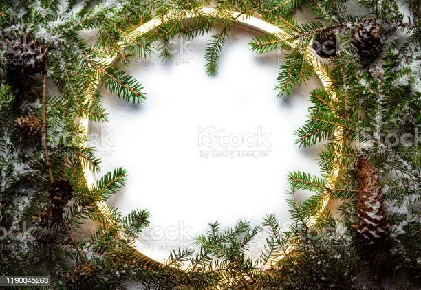 Christmas round frame made by neon and winter things on white picture id1190045263?b=1&k=6&m=1190045263&s=612x612&h=shvcufufyjpkrwbknvgxd6hjewjypeauwvxdikfhesm=