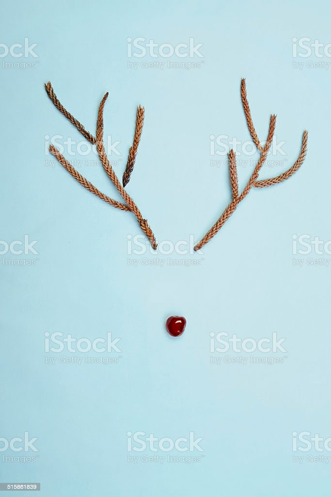 Christmas rudolf reindeer antlers and cherry nose on blue stock photo