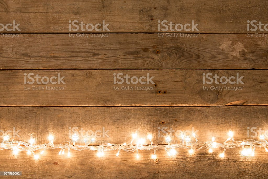 Christmas rustic background - vintage planked wood with lights stock photo