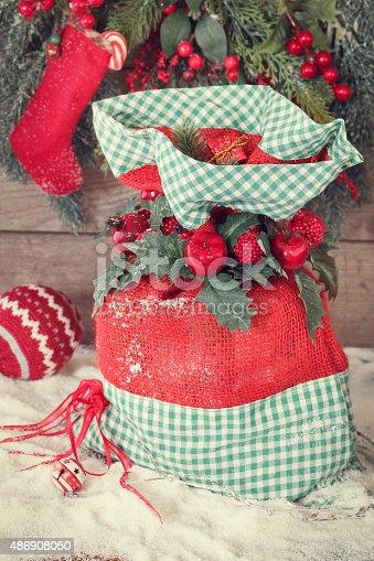 858960516 istock photo Christmas sack full of gifts 486908050