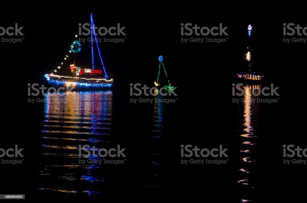 Christmas Sailboats in Nighttime Flotilla stock photo
