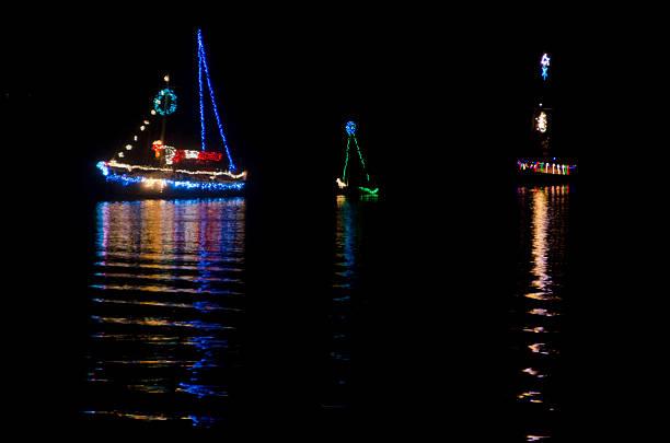Christmas Sailboats in Nighttime Flotilla