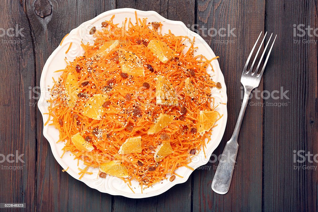 Christmas salad from carrots with orange, raisins and roasted se stock photo